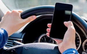 Driving and holding a phone
